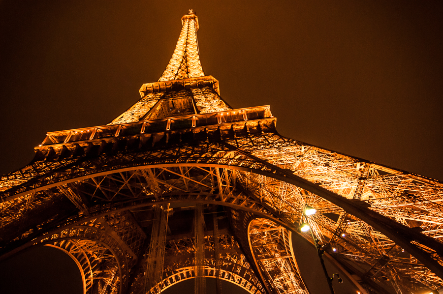 A glowing shot of Eiffel Tower in night lights from Paris by Kimmo Savolainen Photography.