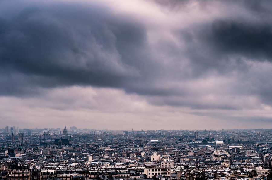 A cityscape photo of storm over Paris' rooftops, urban photography from France by Kimmo Savolainen Photography.