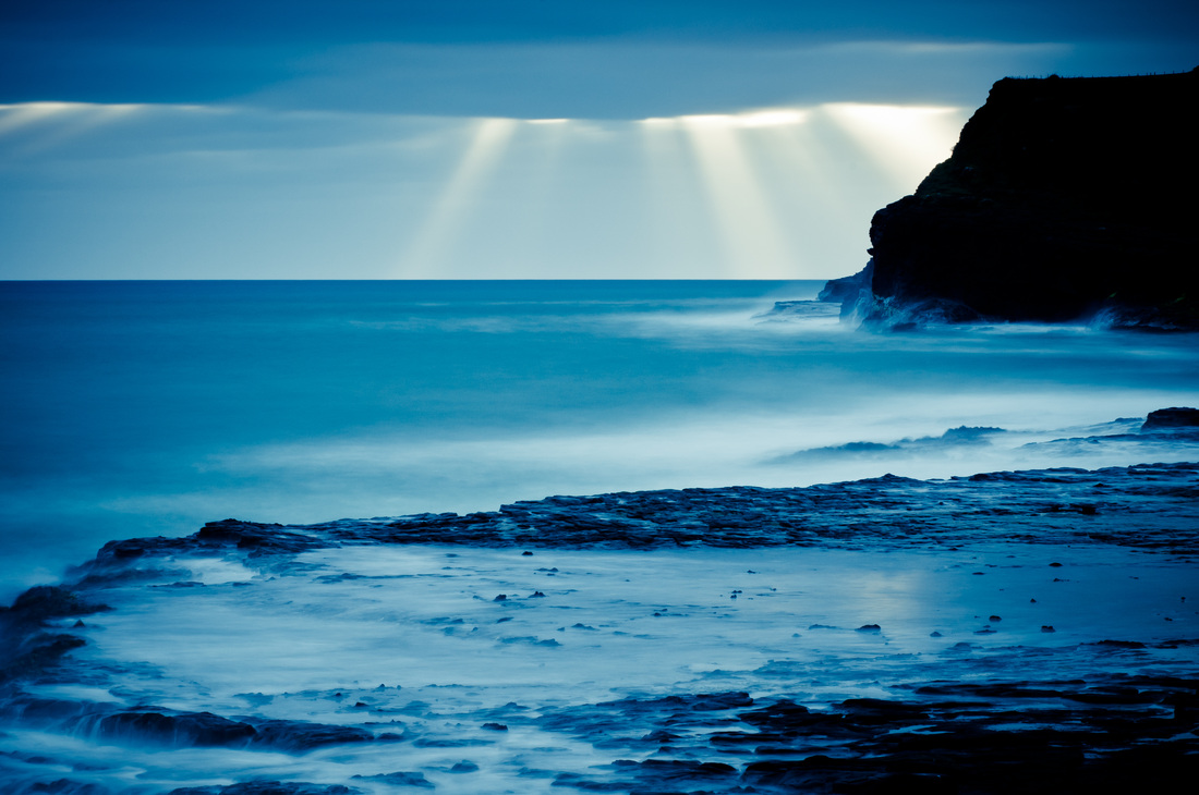 The last sun rays of the sunset - A long exposure landscape from The Catlins, New Zealand by photographer Kimmo Savolainen.