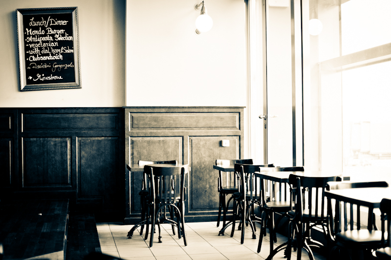 Empty Seats - an urban photograph from an empty cafe by photographer Kimmo Savolainen.