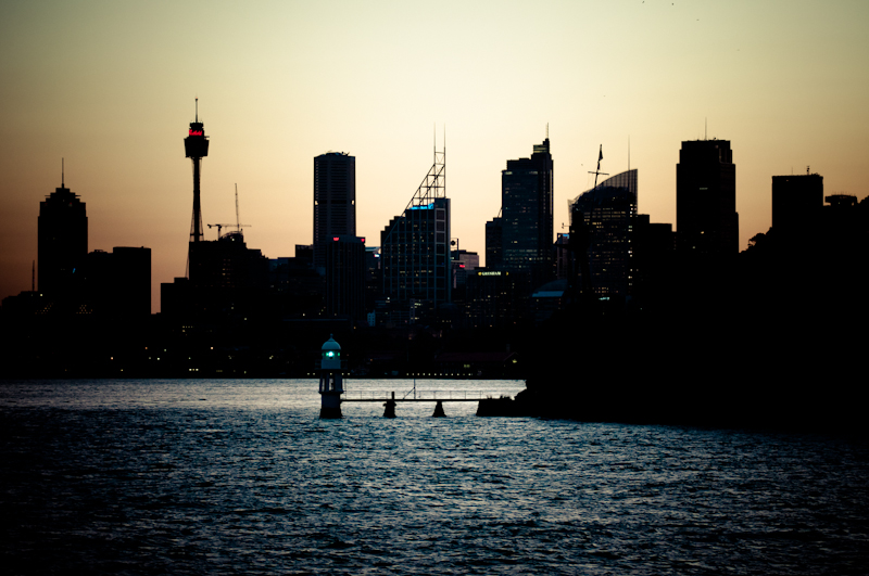 Photograph from Manly ferry, Sydney during sunset. Silhouette from the Sydney city and the Pacific Ocean coast line.