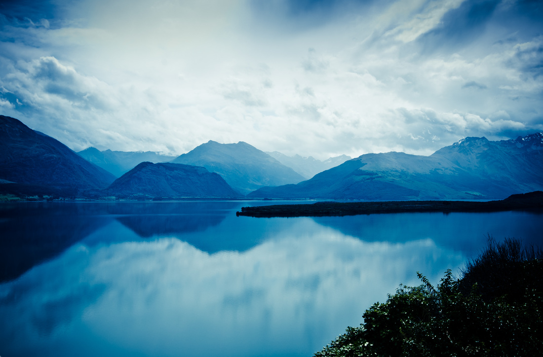 Reflection - a amazing mountain landscape from Lake Wakatipu, New Zealand by photographer Kimmo Savolainen.