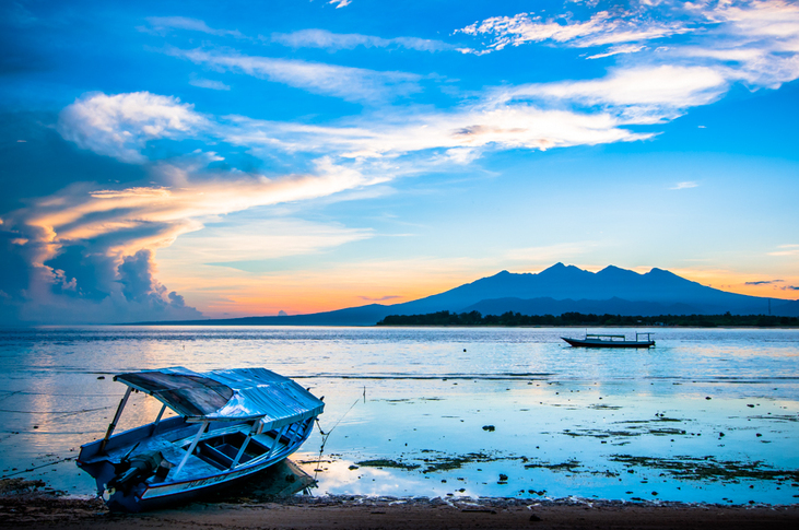 The waiting boats - landscape from Gili Islands, Indonesia by Kimmo Savolainen Photography.